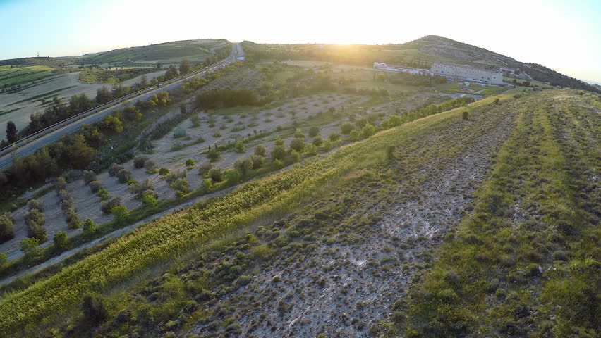 Quadrocopter shooting aerial view, collecting data for cartographers, Cyprus