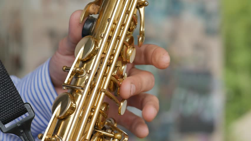 A saxophonist plays the saxophone