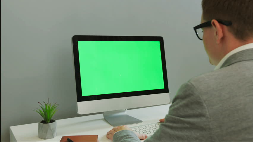Back view of business man working on computer with green screen in the modern office. Chroma key. | Shutterstock HD Video #29854351