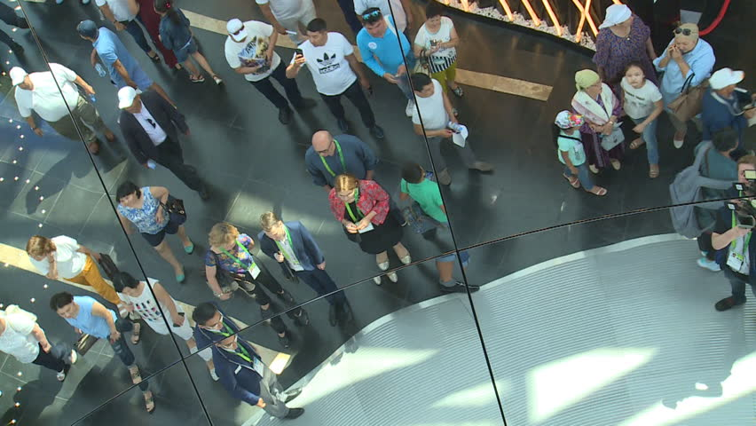 ASTANA, KAZAKHSTAN - July 8, 2017: Tourist people looking at huge round mirror on exhibition space ceiling in EXPO 2017. Handheld tilt down shot. | Shutterstock HD Video #29862259