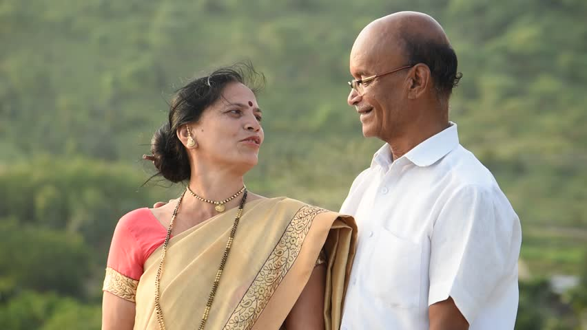 Happy senior couple husband and wife wearing Indian cloth talking and laughing at  outdoors.