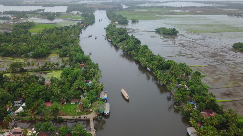 Aerial back to top view of a Boat Houses over the backwaters in Alleppey, Kerela in UHD 4K