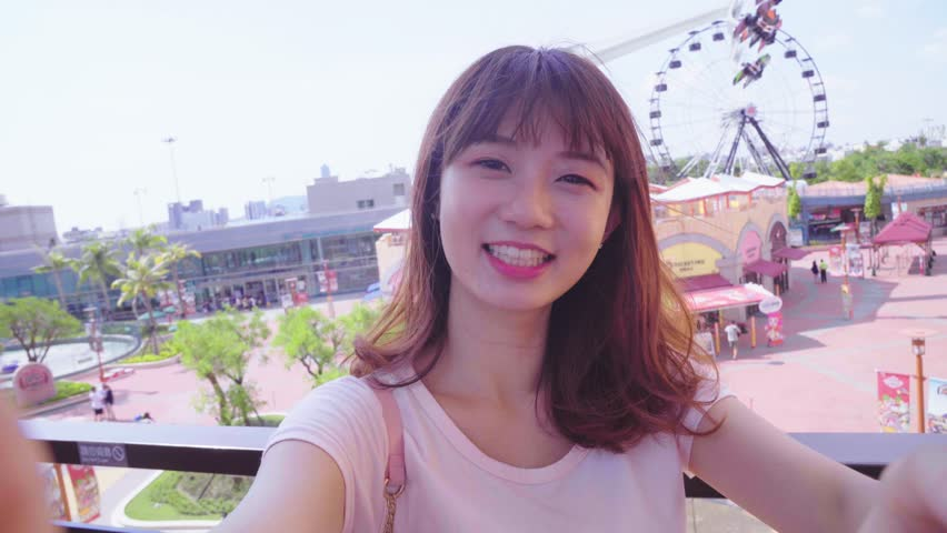Young woman smile take selfie | Shutterstock HD Video #29910229