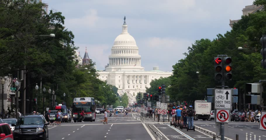 WASHINGTON, D.C. - Circa August, 2017 - A long establishing slow motion shot of the Capitol Dome on Capitol Hill as seen from Pennsylvania Avenue. Shot at 48fps.