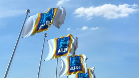 Waving flags with Aldi logo against sky, seamless loop. 4K editorial animation