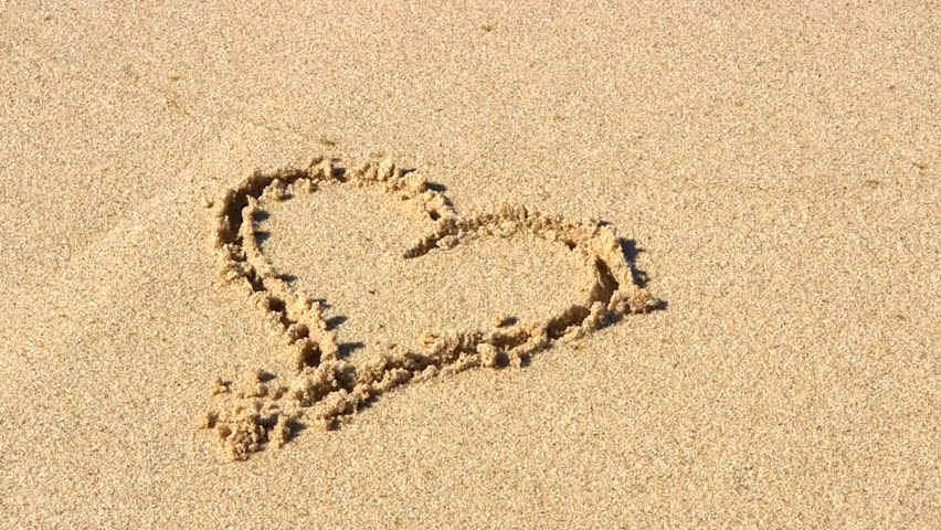 Heart Drawing In The Sand Washed Away By Wave Stock Footage Video