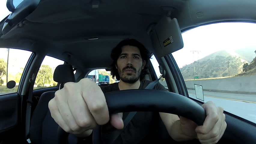 Young man driving angry