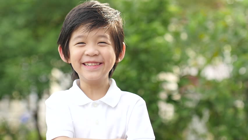 Close up of happy asian child outdoor slow motion | Shutterstock HD Video #30009469