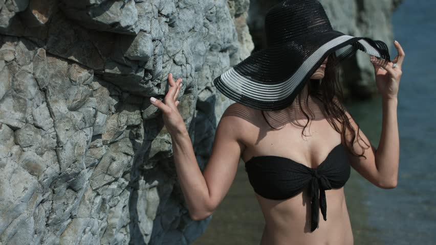 Portrait of the cute girl in the beach hat and the black bikini   Shutterstock HD Video #30020479