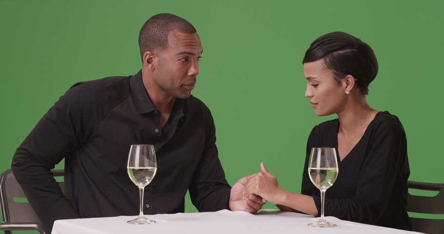 An African American couple get engaged on green screen. On green screen to be keyed or composited.