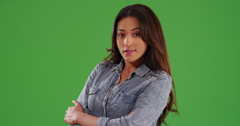 Portrait of beautiful Latina female standing laughing at camera on green screen. On green screen to be keyed or composited. #30031609