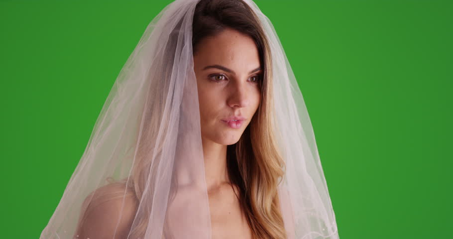 Closeup of beautiful female millennial wearing wedding veil on green screen. On green screen to be keyed or composited. #30033739