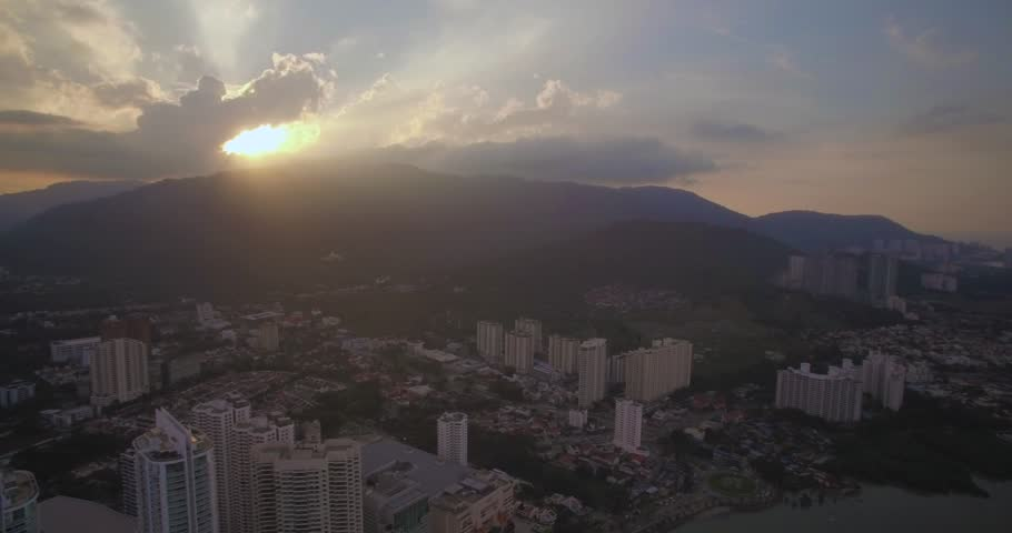 High Aerial Shot of Sunset Behind Hills in Penang, Malaysia | Shutterstock HD Video #30040369