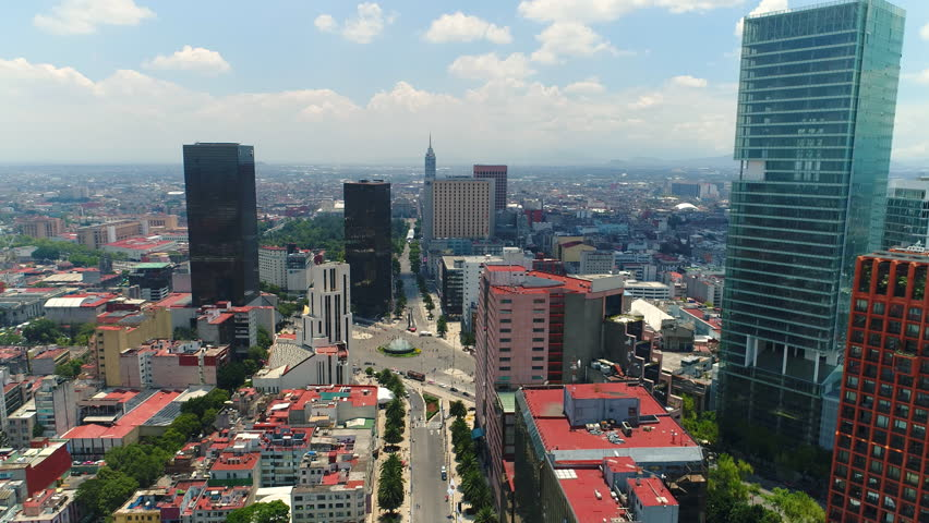 Aerial view of skyline of Mexico City, modern commercial buildings and skyscrapers of business district, capital city of Mexico from above, 4k UHD
