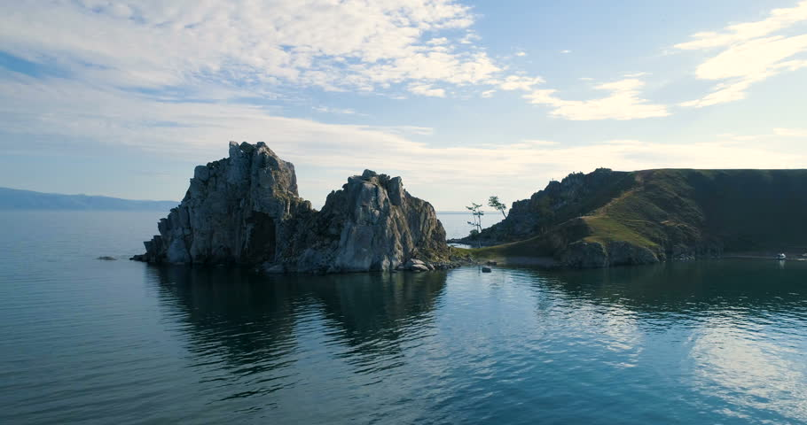 View of the Baikal Bay Shamanka in summer day. Olkhon. Drone footage.A famous tourist site. Symbol of lake Baikal. Cape Burhan