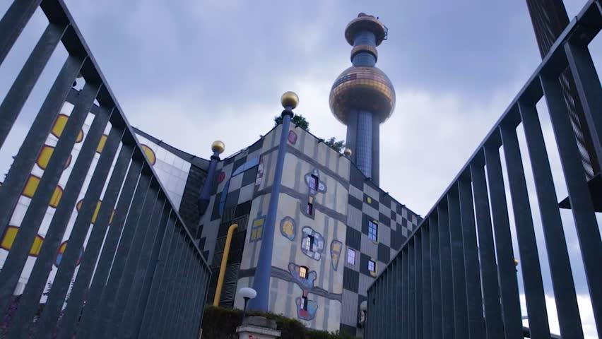 pan exterior District Heating Plant Spittelau, storefront, architectural redesigned by Friedensreich Hundertwasser.
