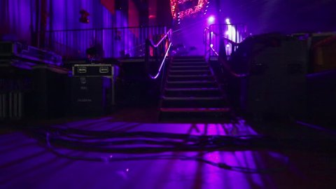 POV of musician entering a stage through stairs for sound check before concert