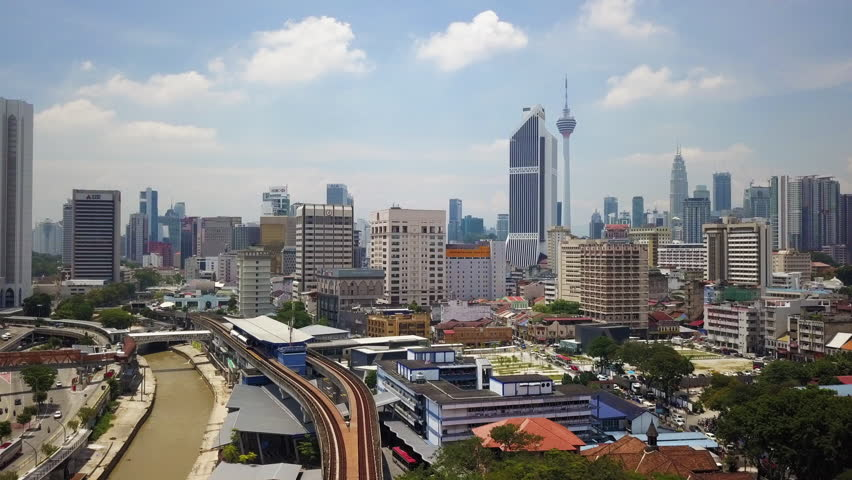 Malaysia, Circa 2017 - Aerial view of Kuala Lumpur with blue sky with Light Rapid Transit (LRT) Elevated track in view which helps the congested city. Malaysia is forecasting a 5% GDP growth this year