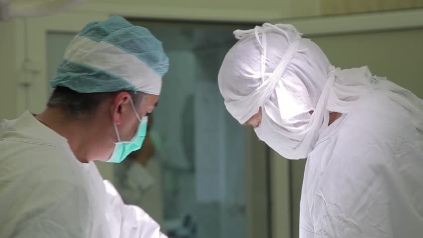Close-up. Surgeons direct light during surgery | Shutterstock HD Video #30131959