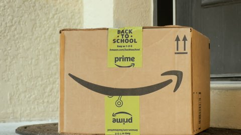 NEW YORK - AUG 24: Amazon Prime box package delivery on August 24, 2017. As of April 2017, Amazon Prime has more than 80 million paying users.