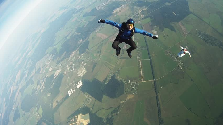CHICAGO, USA - JUNE 26, 2015: Professional skydivers freestyle in sky. Adrenaline. Free falling. Flight Extreme #30189049