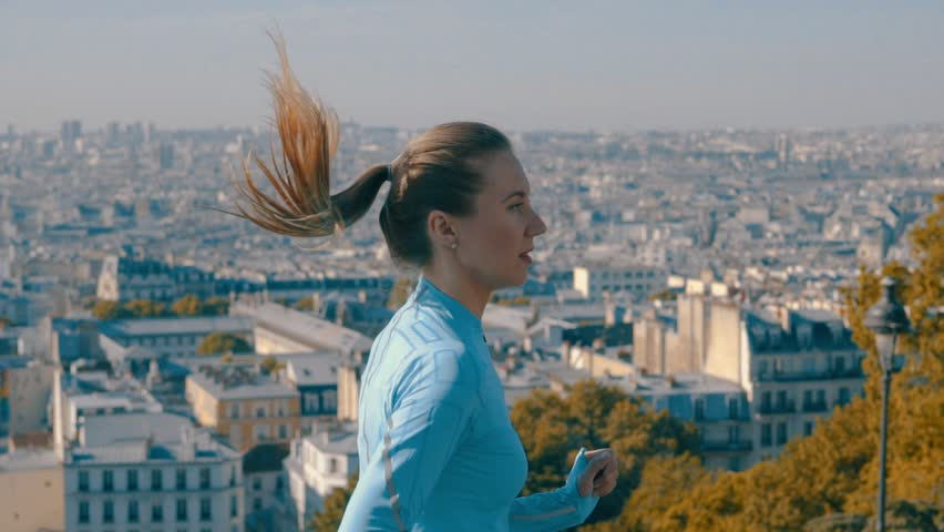 Woman running. Morning runner on the street with beautiful city view in Paris under sunlight. | Shutterstock HD Video #30197389