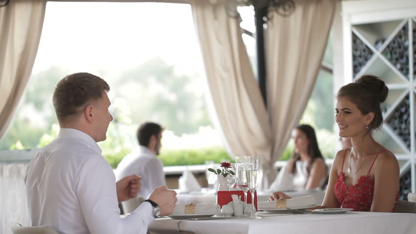 Couple with champagne glasses dating and toasting in restaurant | Shutterstock HD Video #30197599