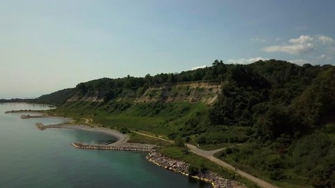 Toronto Ontario Augustaerial drone shot flying over Scarborough bluffs towards land
