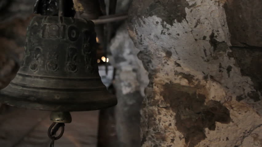 Bell hanging on entrance of  tunnel of the abandoned mine