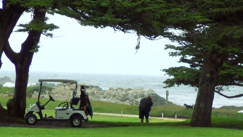 MONTEREY, CA - OCTOBER 5: Golfers at Pebble Beach golf course by the ocean, October 5, 2012 in Monterey, CA. Pebble Beach golf course is the most famous course in the Western United States,