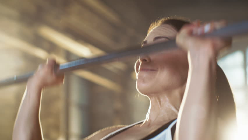 Beautiful Athletic Woman Wipes Sweat from Her Forehead with a Hand. She's Tired after Intensive Fitness Exercise. Shot on RED EPIC-W 8K Helium Cinema Camera. | Shutterstock HD Video #30308449