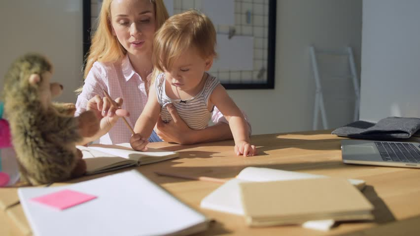Child Development Advice And Parenting Help For Parents Alamy Happy asian family boy and parent drawing together   HD stock video clip