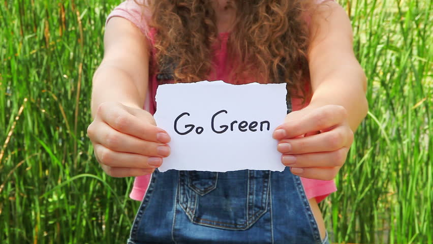 Go green, woman show words on nature