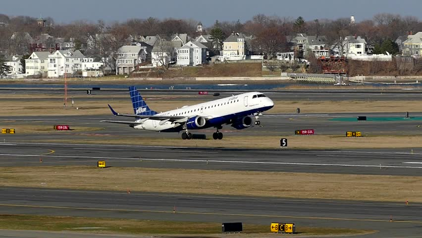 Jet Blue airlines plane taking off from runway, slow motion lift off - Logan Airport Boston, Massachusetts USA - May 2, 2016