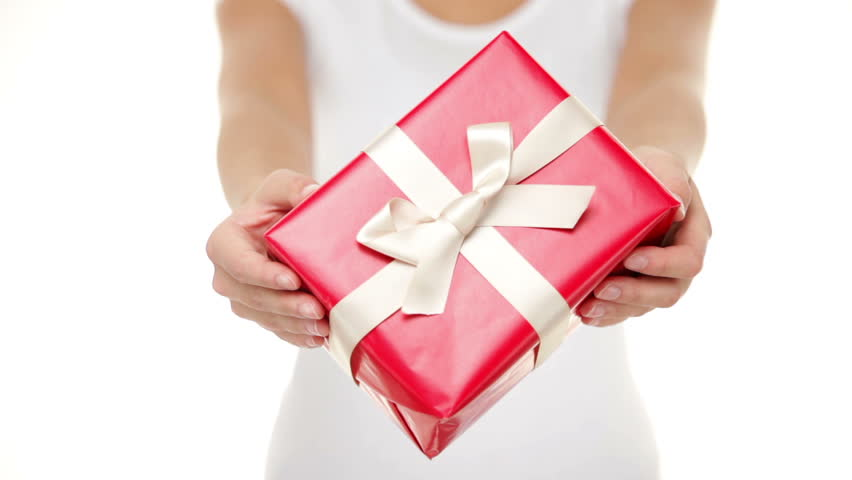 Presents Woman Giving Red And White Gifts Closeup Of Showing Gift Isolated On Pure Background