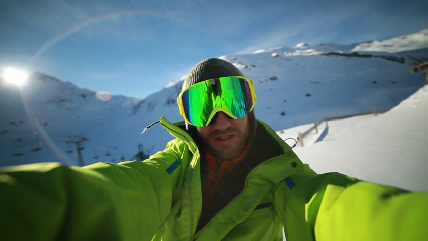 Man taking self portrait from ski slope. Young man skiing in Switzerland takes a selfie  | Shutterstock HD Video #30407149