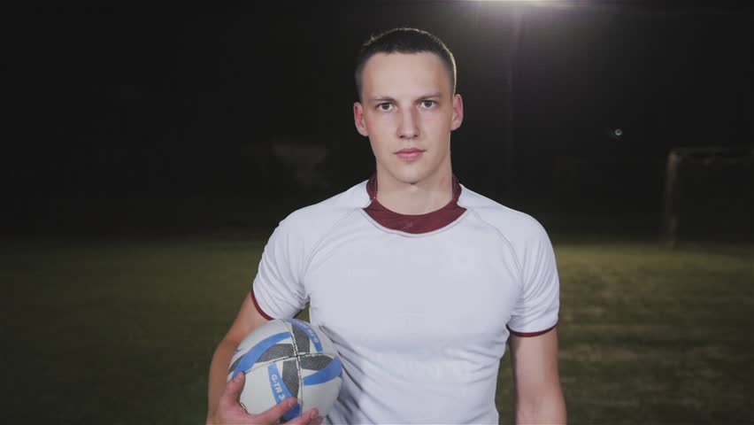 Soccer player standing portrait, football or rugby player professional men outdoor on stadium
