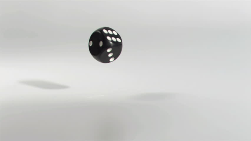One black dice in a super slow motion rebounding against a grey background | Shutterstock HD Video #3042589