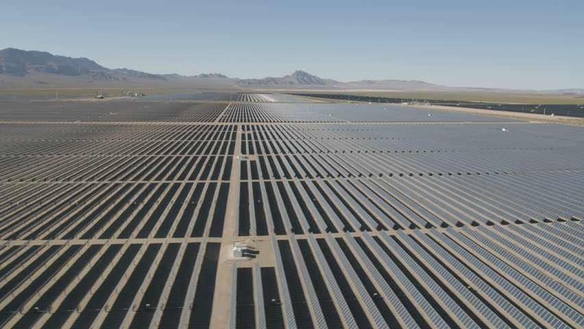 Aerial view Nevada Solar One Photovoltaic Solar units being used to produce natural clean energy for business industrial production Nevada USA RED WEAPON | Shutterstock HD Video #30458359