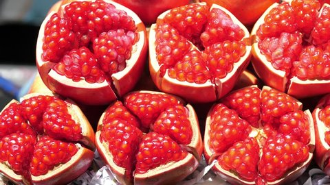 Closeup Of Red Ripe Juicy Pomegranate. Closeup. 4K.