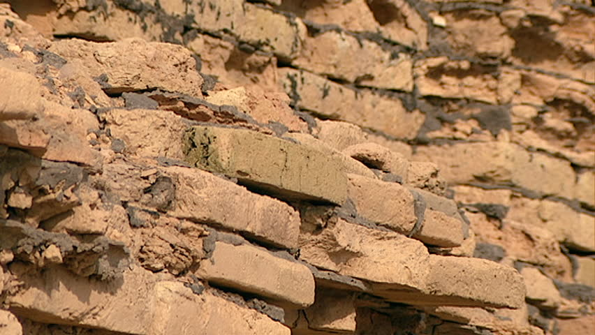 Dried mud bank hd stock footage close up shot of dried mud or tell el muqayyar iraq circa 2002 view of friable ruined mud bricks sciox Images