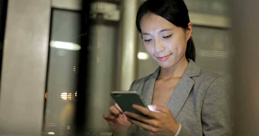 Business woman reply client email on cellphone with window reflection  | Shutterstock HD Video #30532270