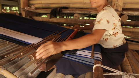 SUMBA, INDONESIA - July 17th, 2017: Woman crafting typical Sumba woven with traditional method.