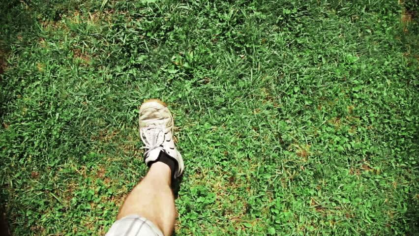 Man Walking on grass  | Shutterstock HD Video #3054523