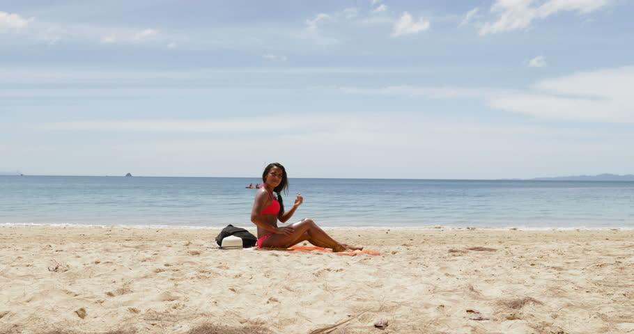 Woman Applying Sun Tanning Lotion On Beach Girl Putting Sunscreen Suntan Cream Relaxing Seaside