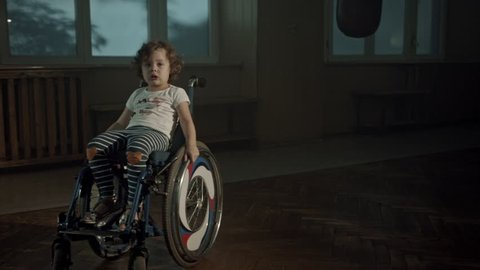 Disabled little girl in a gym