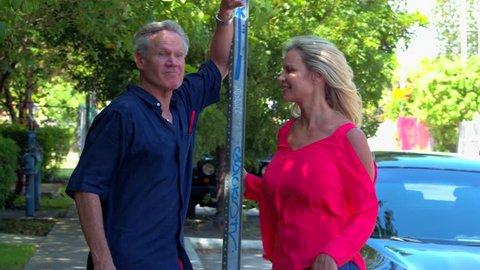 Mature couple talking outdoors