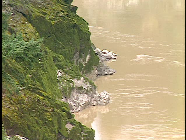 Fraser river close up mossy cliffs muddy water (BetacamSP, good audio) | Shutterstock HD Video #30599