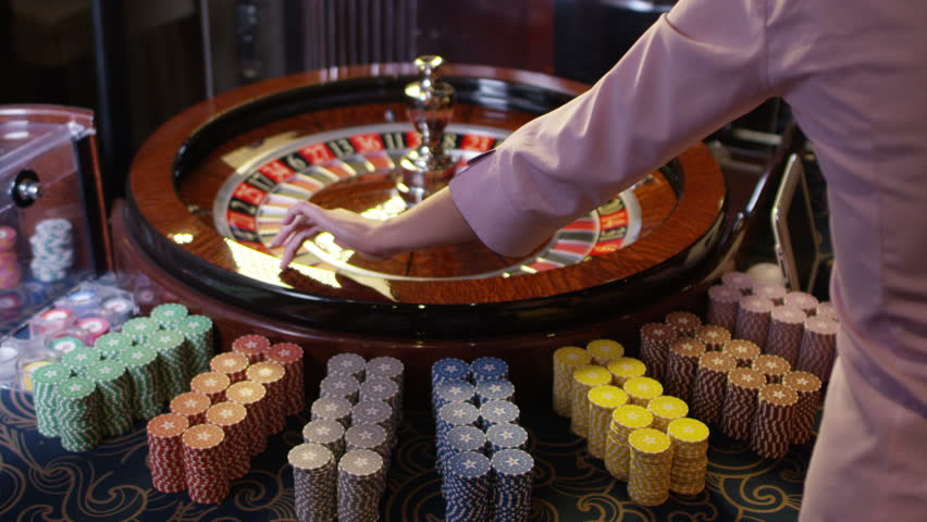Casino roulette in motion, the spinning wheel ball .  Shot on RED EPIC DRAGON Cinema Camera in slow motion.