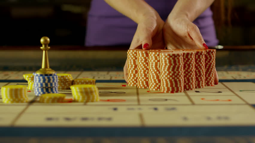 Croupier Moves Chips on Black Jack Table at Casino. Shot on RED EPIC DRAGON Cinema Camera in slow motion. 4K | Shutterstock HD Video #30626650